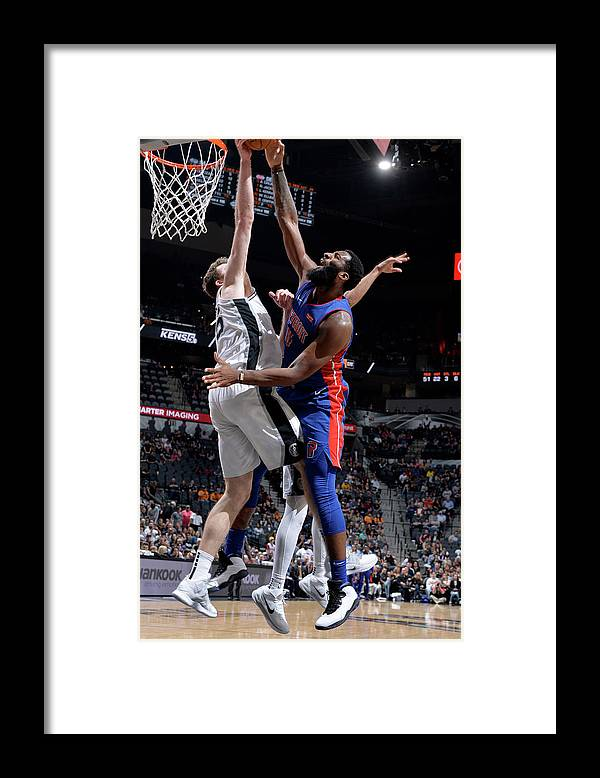 Nba Pro Basketball Framed Print featuring the photograph Andre Drummond and Jakob Poeltl by Mark Sobhani