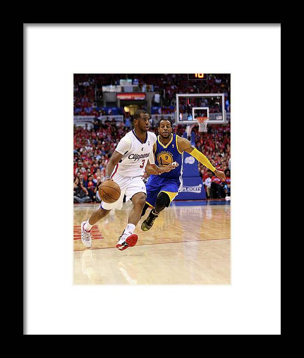 Playoffs Framed Print featuring the photograph Andre Iguodala and Chris Paul by Stephen Dunn