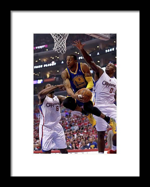 Playoffs Framed Print featuring the photograph Andre Iguodala, Deandre Jordan, and Glen Davis by Stephen Dunn