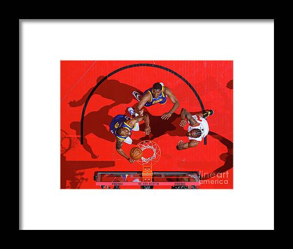 Playoffs Framed Print featuring the photograph Andre Iguodala, Kawhi Leonard, and Kevon Looney by Mark Blinch