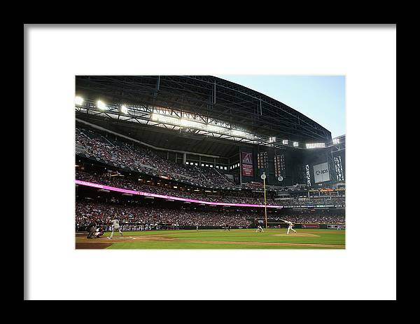 Baseball Pitcher Framed Print featuring the photograph Angel Pagan And Brandon Mccarthy by Christian Petersen