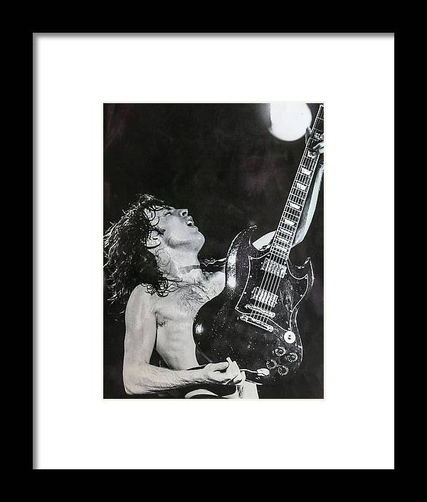 Angus Young Framed Print featuring the photograph Angus Young 1981 ACDC by Leigh Henningham