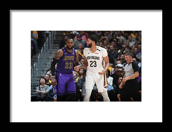 Nba Pro Basketball Framed Print featuring the photograph Anthony Davis and Lebron James by Andrew D. Bernstein