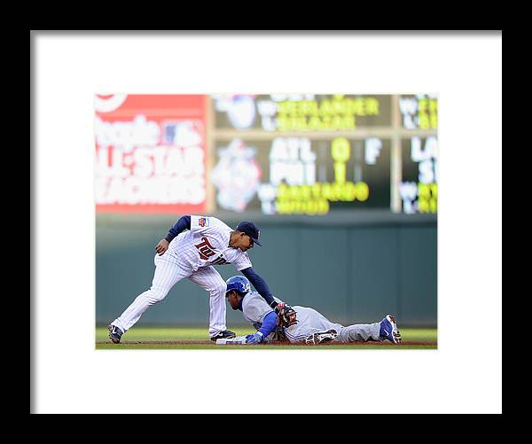 Game Two Framed Print featuring the photograph Anthony Gose and Eduardo Escobar by Hannah Foslien