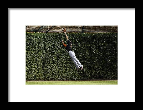 People Framed Print featuring the photograph Anthony Rizzo and Giancarlo Stanton by David Banks