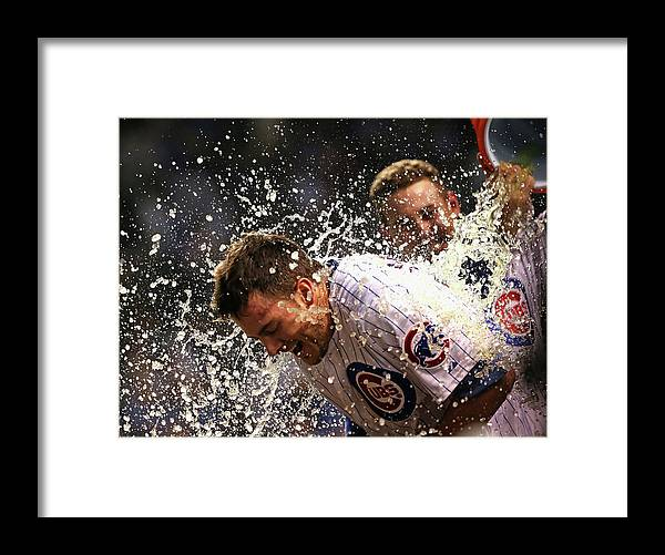 People Framed Print featuring the photograph Anthony Rizzo and Kris Bryant by Jonathan Daniel