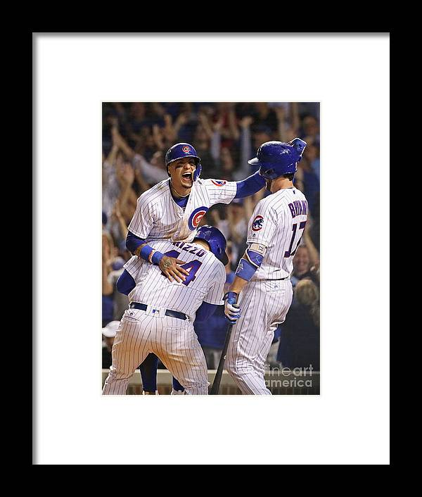 People Framed Print featuring the photograph Anthony Rizzo, Kris Bryant, And Javier Baez by Jonathan Daniel