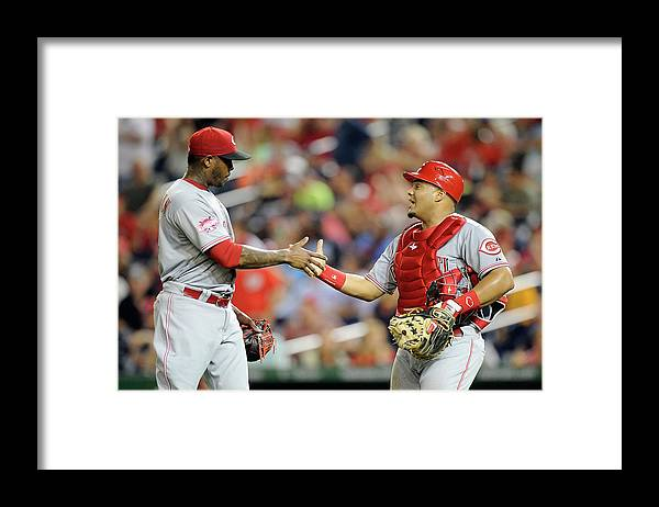 Three Quarter Length Framed Print featuring the photograph Aroldis Chapman and Brayan Pena by Greg Fiume