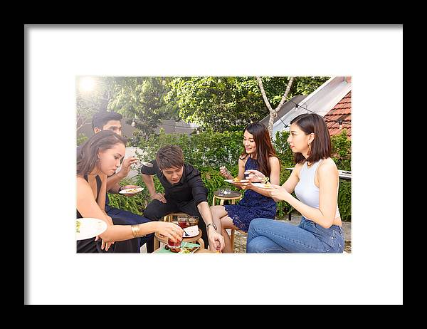 Young Men Framed Print featuring the photograph Asian Friends Enjoying Outdoor Roof Top Party by Thurtell