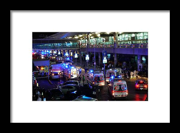 Ambulance Framed Print featuring the photograph At Least 10 Killed In Suicide Bomb Attack On Ataturk International Airport In Istanbul by Getty Images