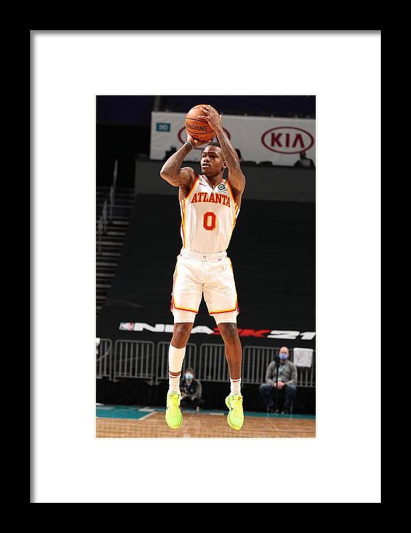 Nba Pro Basketball Framed Print featuring the photograph Atlanta Hawks v Charlotte Hornets by Kent Smith