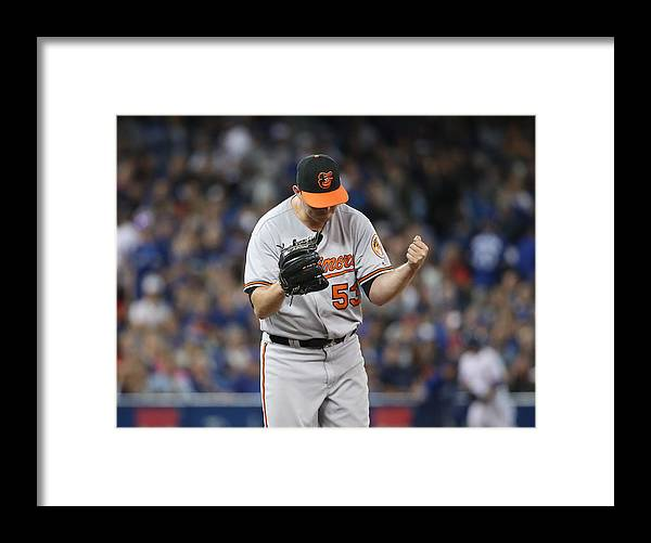 Three Quarter Length Framed Print featuring the photograph Baltimore Orioles v Toronto Blue Jays by Tom Szczerbowski