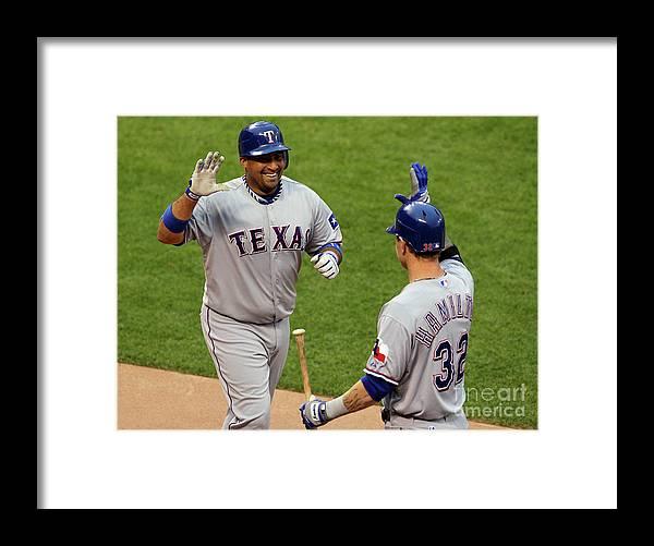 American League Baseball Framed Print featuring the photograph Bengie Molina and Josh Hamilton by Justin Sullivan