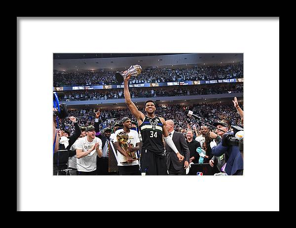 Playoffs Framed Print featuring the photograph Bill Russell and Giannis Antetokounmpo by Jesse D. Garrabrant