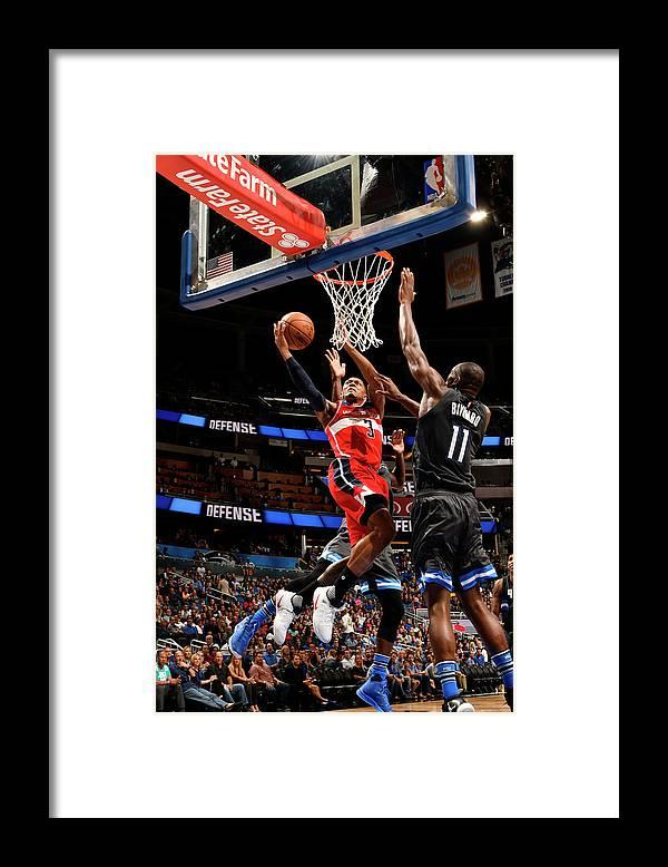 Nba Pro Basketball Framed Print featuring the photograph Bismack Biyombo and Bradley Beal by Fernando Medina