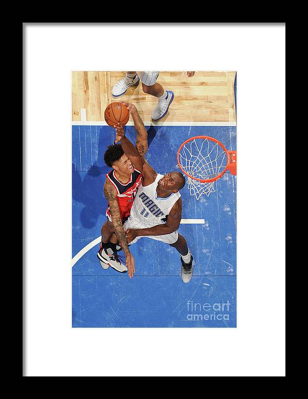 Nba Pro Basketball Framed Print featuring the photograph Bismack Biyombo and Kelly Oubre by Fernando Medina