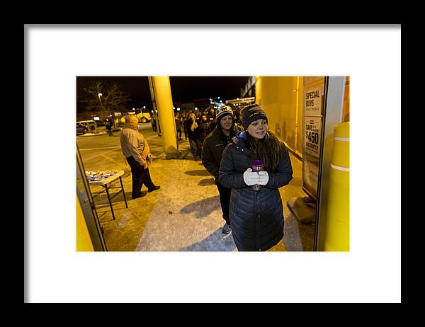 Event Framed Print featuring the photograph Black Friday Shoppers Look For Holiday Bargains by Darren Hauck