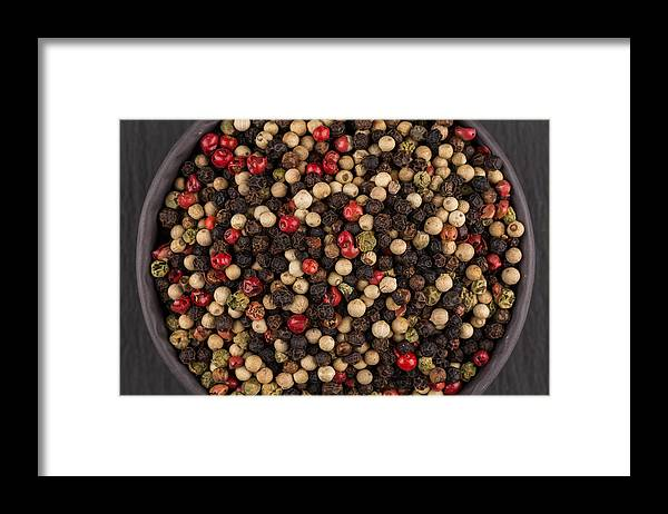 Black Color Framed Print featuring the photograph Bowl Of Various Pepper Peppercorns Seeds Mix On Dark Stone by R.Tsubin