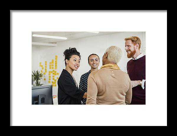 Working Framed Print featuring the photograph Brainstorming as a Group by SolStock