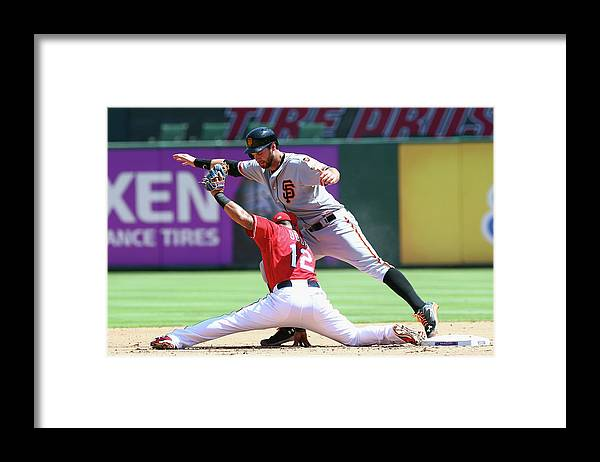 People Framed Print featuring the photograph Brandon Belt and Rougned Odor by Ronald Martinez