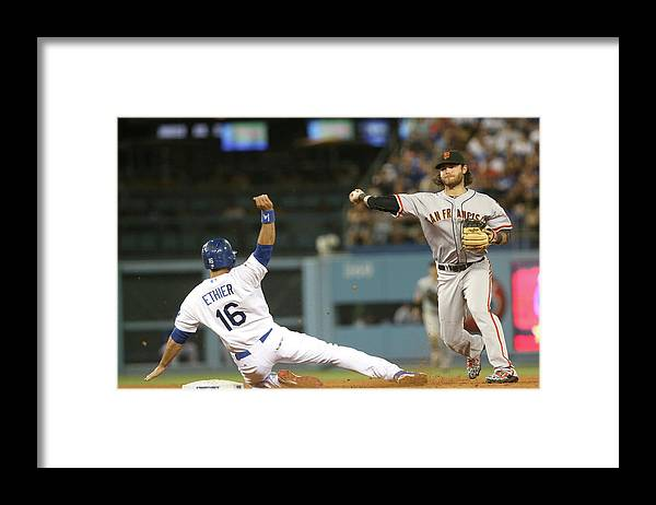 Double Play Framed Print featuring the photograph Brandon Crawford and Andre Ethier by Stephen Dunn