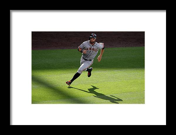 People Framed Print featuring the photograph Brandon Crawford and Brandon Belt by Doug Pensinger