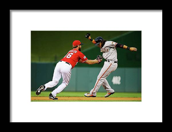 National League Baseball Framed Print featuring the photograph Brandon Crawford and Matt Thornton by Al Bello