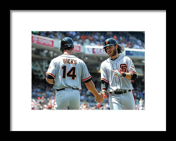 Second Inning Framed Print featuring the photograph Brandon Hicks and Brandon Crawford by Denis Poroy