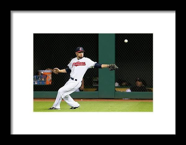 People Framed Print featuring the photograph Brandon Moss And Adam Jones by Jason Miller