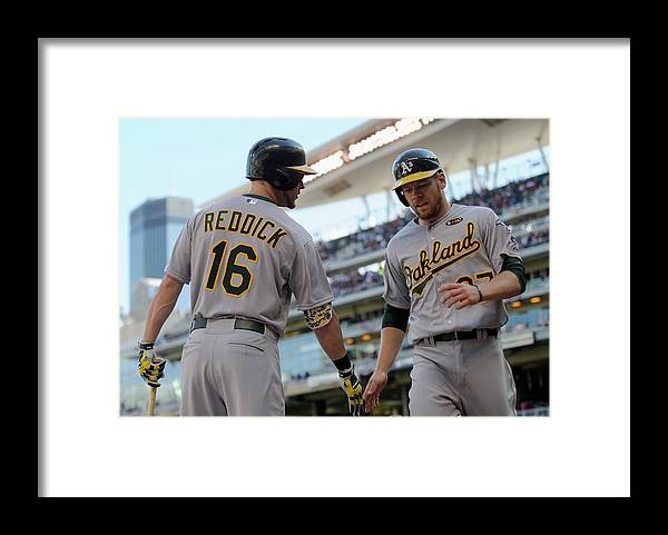 Second Inning Framed Print featuring the photograph Brandon Moss and Josh Reddick by Hannah Foslien