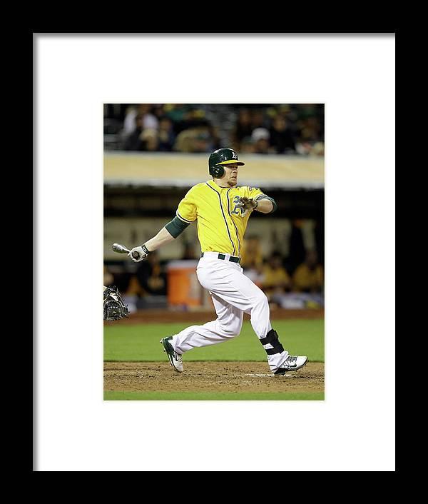 American League Baseball Framed Print featuring the photograph Brandon Moss by Ezra Shaw