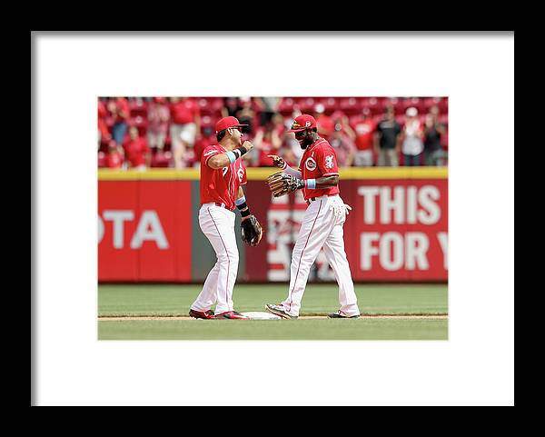 Great American Ball Park Framed Print featuring the photograph Brandon Phillips and Eugenio Suarez by Andy Lyons