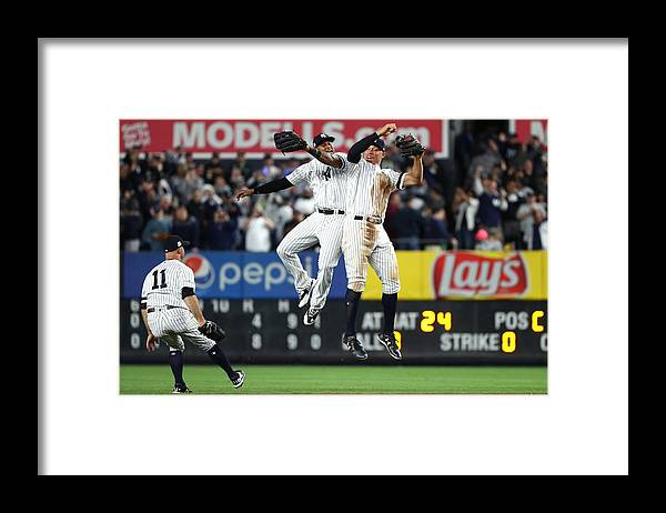 Playoffs Framed Print featuring the photograph Brett Gardner, Aaron Judge, and Aaron Hicks by Al Bello