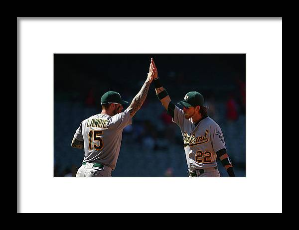 People Framed Print featuring the photograph Brett Lawrie and Josh Reddick by Victor Decolongon