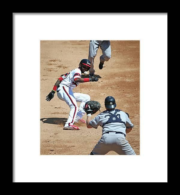 Brian Mccann Framed Print featuring the photograph Brian Mccann and Alexei Ramirez by Jonathan Daniel
