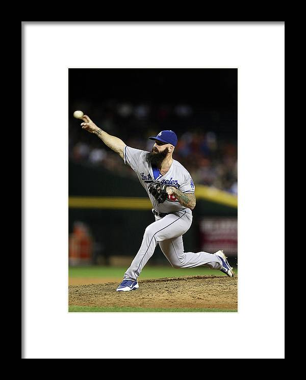 Relief Pitcher Framed Print featuring the photograph Brian Wilson by Christian Petersen