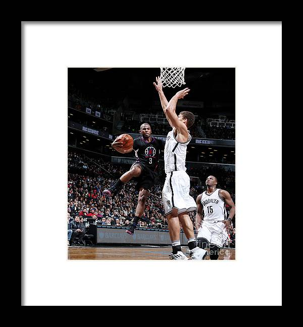 Nba Pro Basketball Framed Print featuring the photograph Brook Lopez and Chris Paul by Nathaniel S. Butler