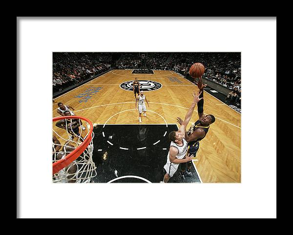 Nba Pro Basketball Framed Print featuring the photograph Brook Lopez and Roy Hibbert by Nathaniel S. Butler