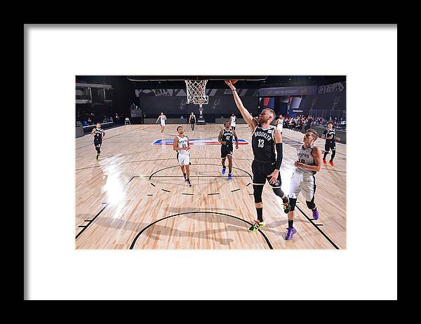 Nba Pro Basketball Framed Print featuring the photograph Brooklyn Nets v San Antonio Spurs by Jesse D. Garrabrant