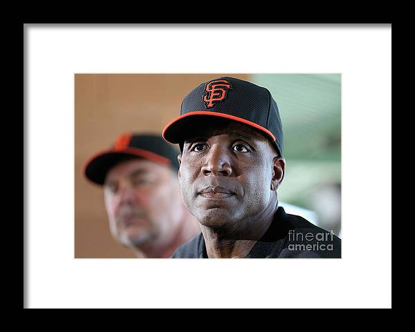 Bruce Bochy Framed Print featuring the photograph Bruce Bochy and Barry Bonds by Christian Petersen