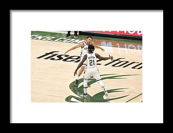 Playoffs Framed Print featuring the photograph Bryn Forbes and Jrue Holiday by Kamil Krzaczynski