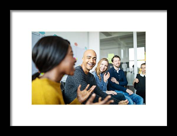 New Business Framed Print featuring the photograph Business team smiling during a meeting by Luis Alvarez