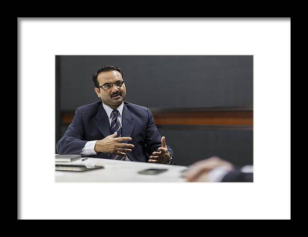 Corporate Business Framed Print featuring the photograph Businessman explaining idea in office meeting by Shannon Fagan