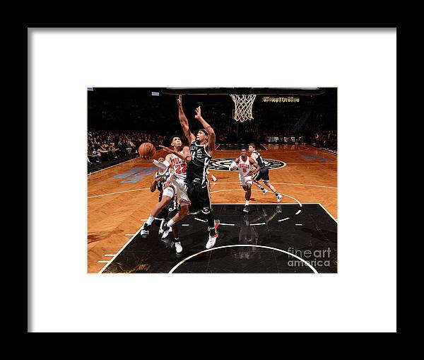 Nba Pro Basketball Framed Print featuring the photograph Cameron Payne and Drazen Petrovic by Jesse D. Garrabrant