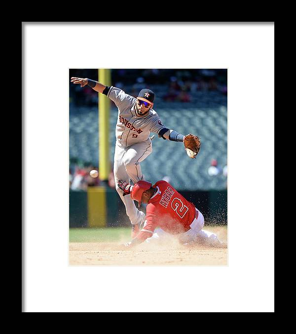 American League Baseball Framed Print featuring the photograph Carlos Corporan and Erick Aybar by Harry How