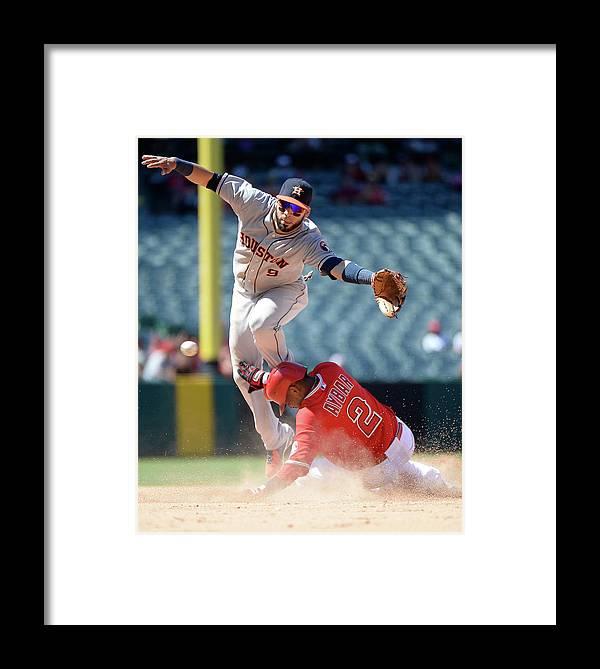 American League Baseball Framed Print featuring the photograph Carlos Corporan And Erick Aybar by Harry How