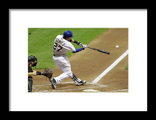 Scoring Framed Print featuring the photograph Carlos Gomez and Rickie Weeks by Mike Mcginnis