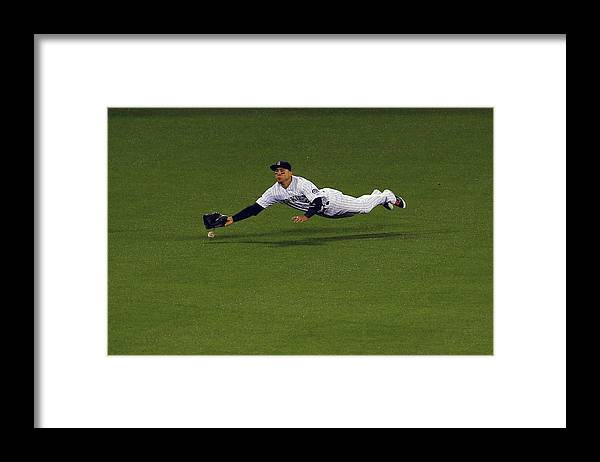 Carlos Gonzalez - Us Baseball Player Framed Print featuring the photograph Carlos Gonzalez and Adrian Gonzalez by Justin Edmonds
