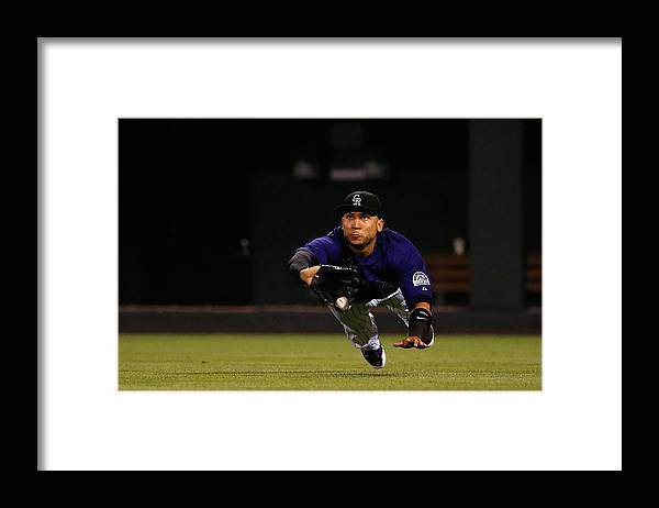 People Framed Print featuring the photograph Carlos Gonzalez and Pete Kozma by Doug Pensinger