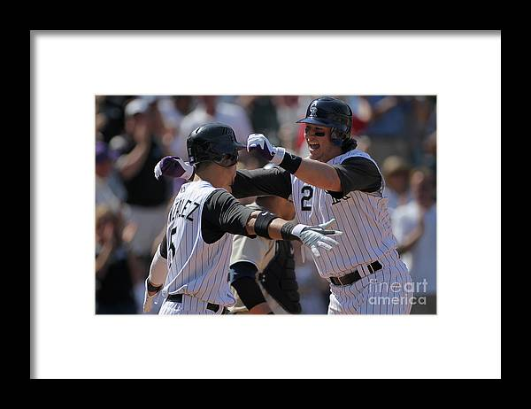 Scoring Framed Print featuring the photograph Carlos Gonzalez and Troy Tulowitzki by Doug Pensinger